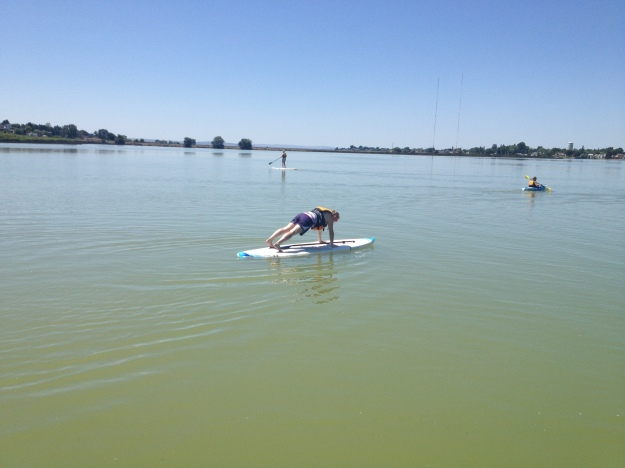 planking on the paddleboard
